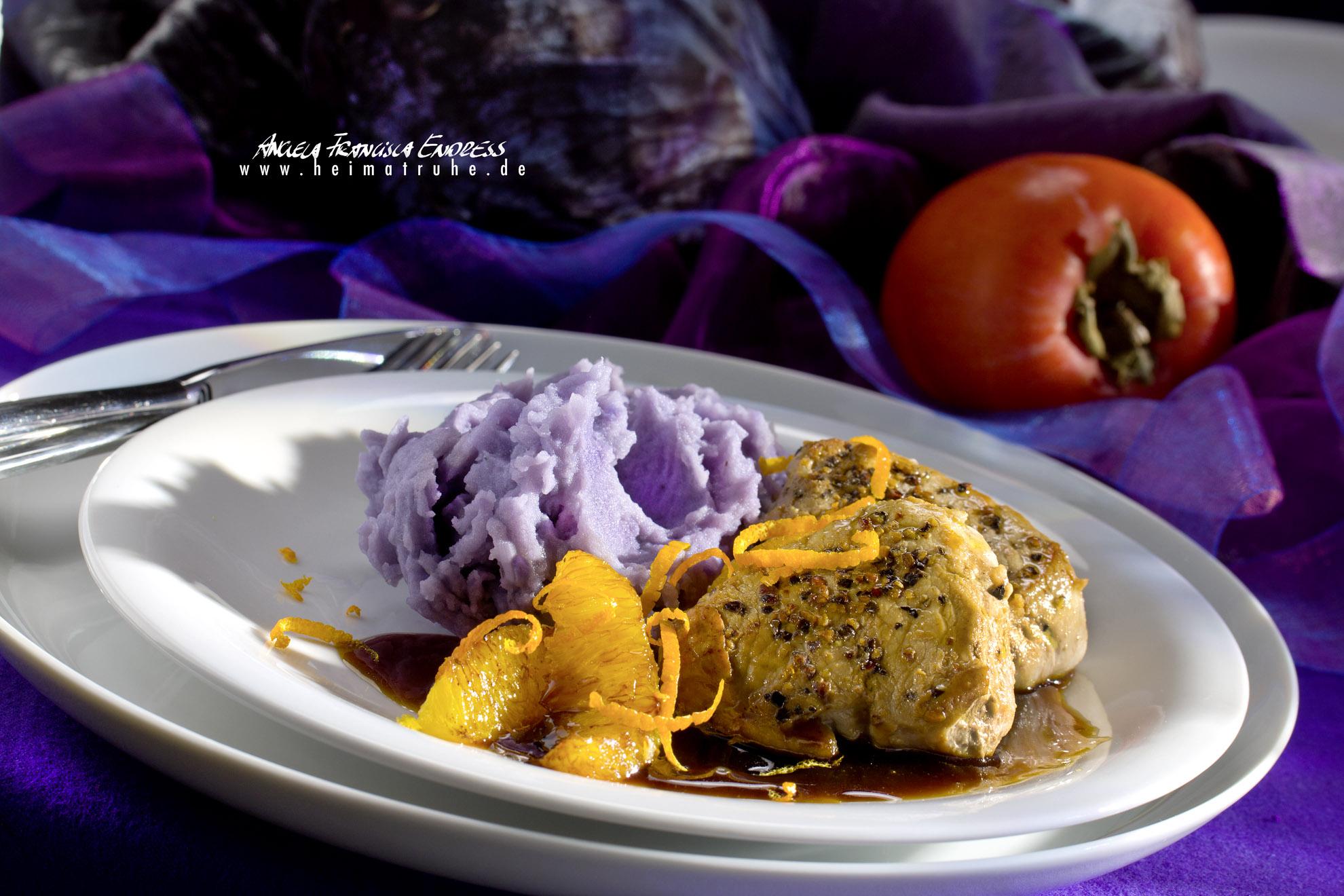 Blaues Kartoffelpürée, Orangen-Zesten und Filets, Schweine-Medallions